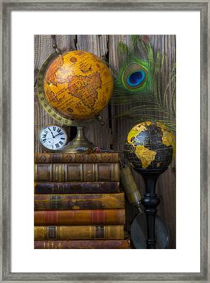 Globes And Old Books Framed Print by Garry Gay