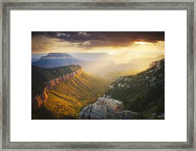 Glow Of The Gods Framed Print by Peter Coskun