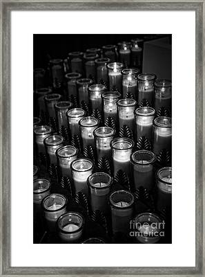 Glowing Candles In A Church Framed Print
