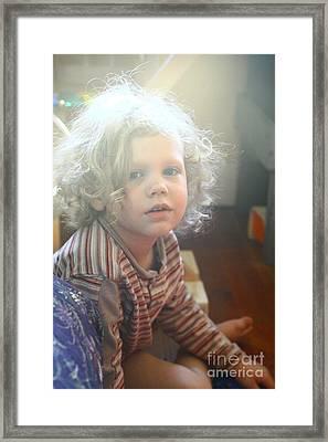 Glowing Child  Framed Print by Carl Warren