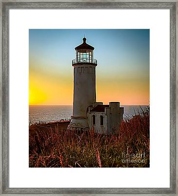 Glowing Lighthouse Framed Print