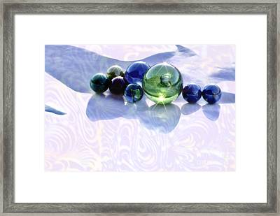 Glowing Marbles Framed Print