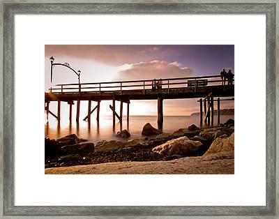 Glowing Pier Framed Print