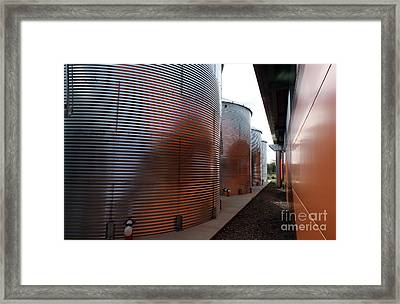 Glowing Silos Framed Print by Juan Romagosa