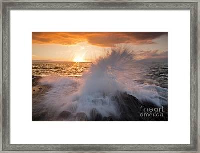 Glowing Sunset Splash Framed Print by Paul Karanik