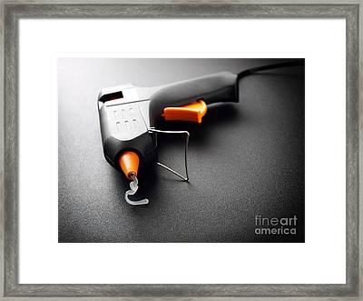 Glue Gun Framed Print by Sinisa Botas