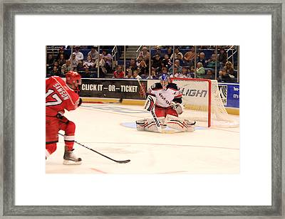 Goalie Protects Framed Print by Karol Livote