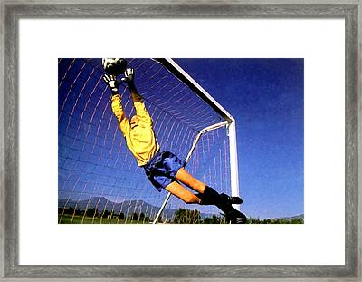 Goalkeeper Catches The Ball Framed Print by Lanjee Chee
