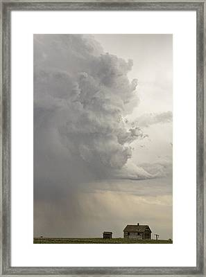 Gobbled Up By A Storm Framed Print