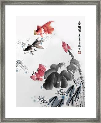 Framed Print featuring the photograph Gold Fish In Lotus Pond by Yufeng Wang