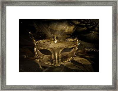 Gold In The Mask Framed Print
