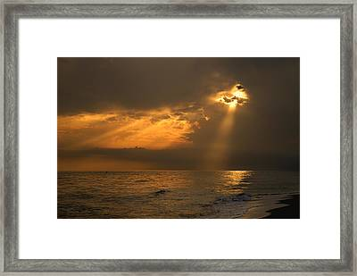 Gold Through The Clouds Framed Print by Guido Montanes Castillo