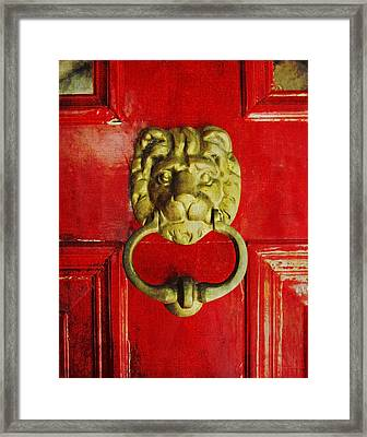 Golden Brass Lion On Red Door Framed Print