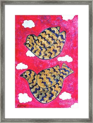 Golden Doves Pink Sky Framed Print by Caroline Street