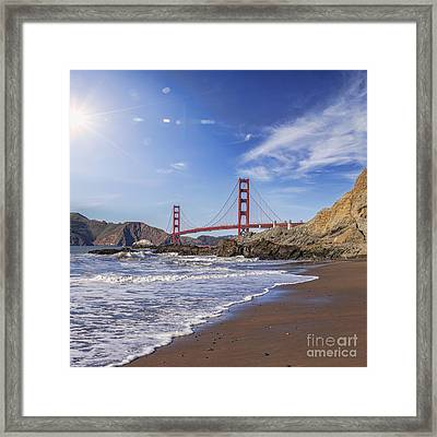 Golden Gate Bridge With Sun Flare Framed Print by Colin and Linda McKie
