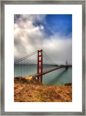 Golden Gate In The Clouds Framed Print by Peter Tellone
