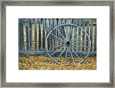 Golden Leaves And Old Wagon Wheel Against A Fence Framed Print