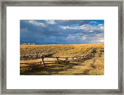 Golden Light On A Stormy Prairie Framed Print