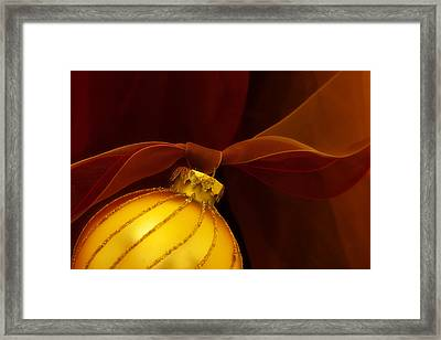 Golden Ornament With Red Ribbons Framed Print by Carol Leigh