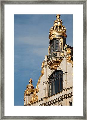 Golden Statuary Decorates The Downtown Framed Print by Dave Bartruff