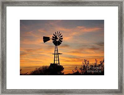 Golden Windmill Silhouette Framed Print by Robert D  Brozek