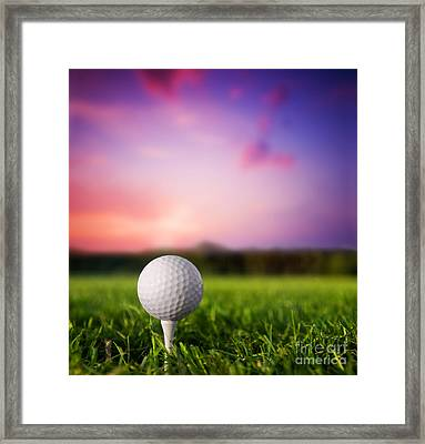 Golf Ball On Tee At Sunset Framed Print