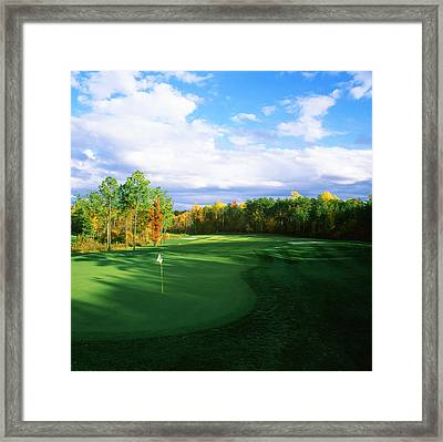 Golf Flag In A Golf Course, Augustine Framed Print by Panoramic Images