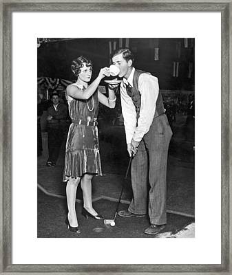 Golf Player Gets Coffee Boost Framed Print by Underwood Archives