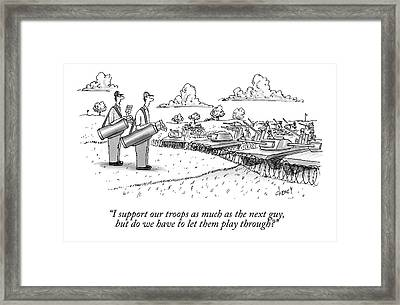 Golfing Through A Warzone Framed Print by Tom Cheney