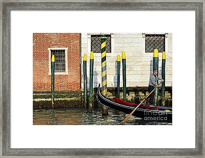 Gondola By Buildings On Grand Canal Framed Print by Sami Sarkis