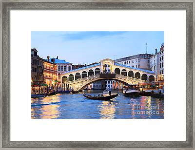 Gondola In Front Of Rialto Bridge At Dusk Venice Italy Framed Print