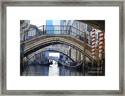 Gondolas And Bridges On Canal Framed Print by Sami Sarkis