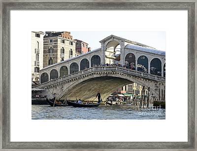 Gondolas Beneath Rialto Bridge On Grand Canal Framed Print by Sami Sarkis
