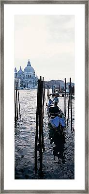Gondolier In A Gondola With A Cathedral Framed Print by Panoramic Images