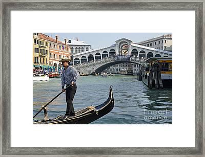 Gondolier On Gondola By Rialto Bridge Framed Print by Sami Sarkis