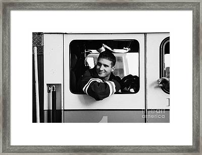 good looking male FDNY fireman looks back out of window of fire truck new york city Framed Print