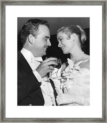 Grace Kelly Toasts With Husband Framed Print