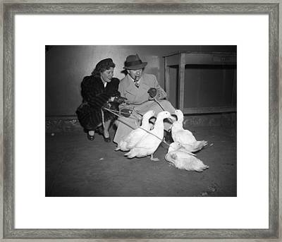 Gracie Allen And George Burns Playing With Ducks Framed Print