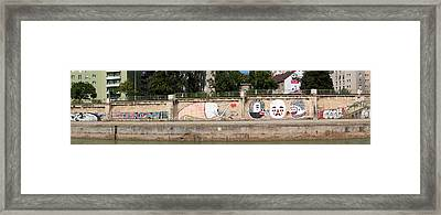 Graffiti On A Wall At The Riverside Framed Print by Panoramic Images