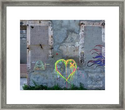 Graffiti On A Wall Damaged. France. Europe. Framed Print
