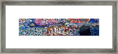 Graffiti On City Wall Framed Print