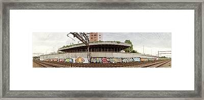 Graffiti On The Wall Along A Railroad Framed Print