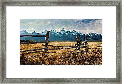 Grand Tetons And Girl On Fence Framed Print by June Jacobsen