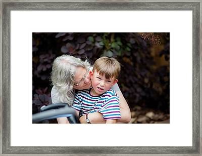 Grandmother Hugging Grandson Framed Print by Samuel Ashfield
