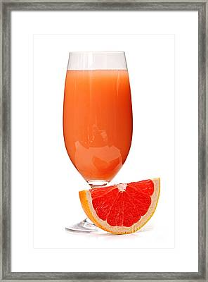 Grapefruit Juice In Glass Framed Print by Elena Elisseeva