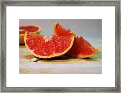 Grapefruit Slices Framed Print by Joseph Skompski