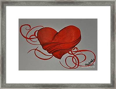 Grasping For A Heart Framed Print