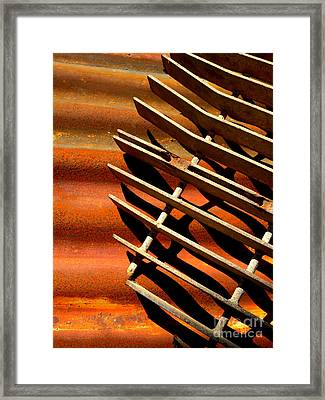 Grate Shadows Framed Print
