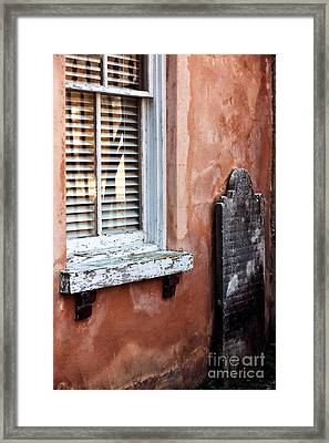 Grave By The Window Framed Print by John Rizzuto