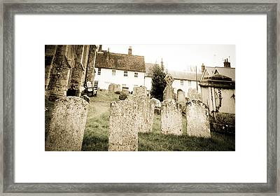 Grave Yard Framed Print by Tom Gowanlock